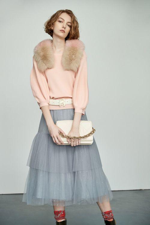 Fold the bright mesh skirt