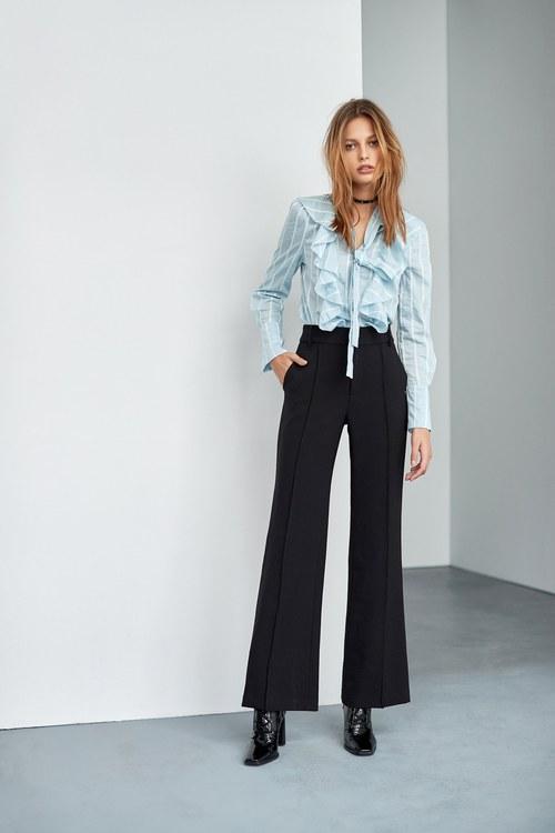 Elastic mid-waist slim trousers