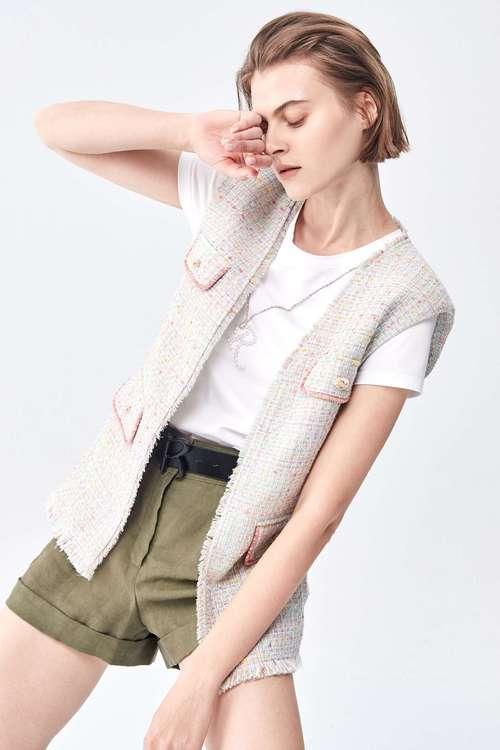 Roll-edge wool vest coat.